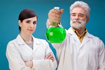 two chemical engineers conducting a chemistry experiment
